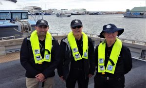FRDC's Managing Director Dr Patrick Hone (centre) and FRDC General managers John Wilson (right) and Crispian Ashby (left) showing the importance of wearing safety gear while on the water. Photo credit: FRDC