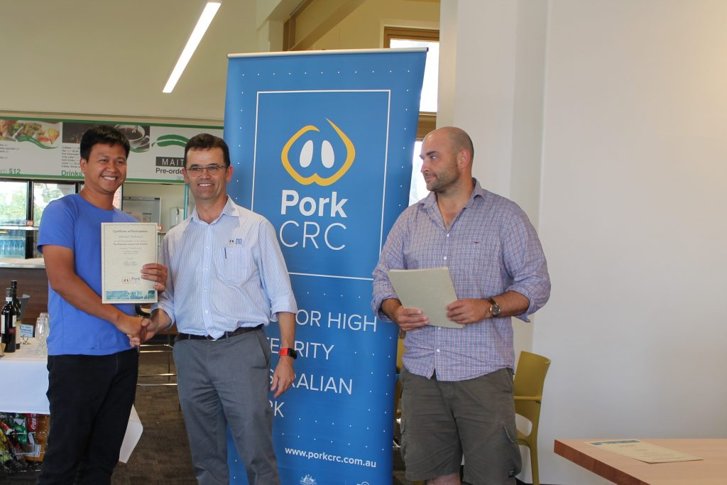 Rhomel Tabunar, Patao Farms, New Zealand, Charles Rikard-Bell, Pork CRC and Will van Wettere, University of Adelaide at the 2018 Science and Practice of Pig Production course.