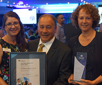 Karen Thomas with Luciano and Heather Corallo at the awards dinner